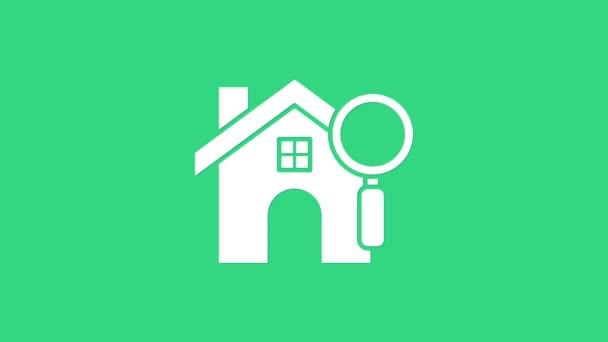 White Search Haus Symbol isoliert auf grünem Hintergrund. Immobilien-Symbol eines Hauses unter der Lupe. 4K Video Motion Grafik Animation