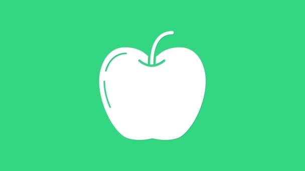 Ikona White Apple izolovaná na zeleném pozadí. Ovoce se symbolem listu. Grafická animace pohybu videa 4K