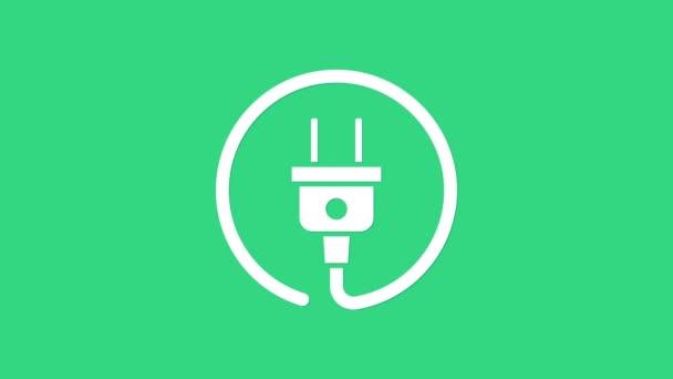 Fehér Elektromos dugó ikon elszigetelt zöld háttérrel. A villamos energia csatlakoztatásának és lekapcsolásának fogalma. 4K Videó mozgás grafikus animáció