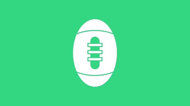 Fehér Amerikai futball ikon elszigetelt zöld háttérrel. Rögbi labda ikon. Csapat sport játék szimbólum. 4K Videó mozgás grafikus animáció