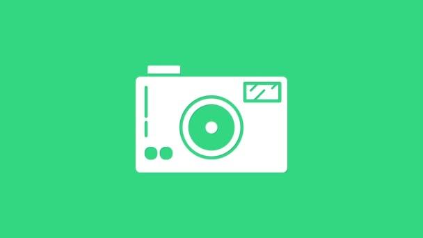 Weißes Symbol der Fotokamera isoliert auf grünem Hintergrund. Ikone der Fotokamera. 4K Video Motion Grafik Animation