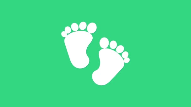 Fehér Baba lábnyomok ikon elszigetelt zöld háttérrel. Babacipő jel. 4K Videó mozgás grafikus animáció