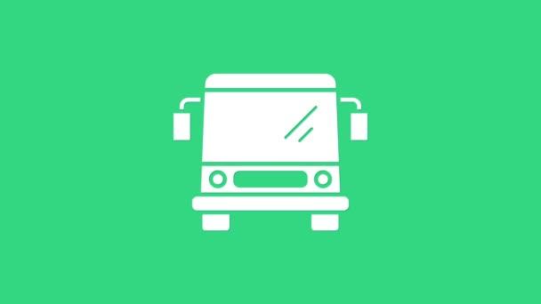 Fehér busz ikon elszigetelt zöld alapon. Közlekedési koncepció. Buszos közlekedési tábla. Turizmus vagy közösségi jármű szimbólum. 4K Videó mozgás grafikus animáció