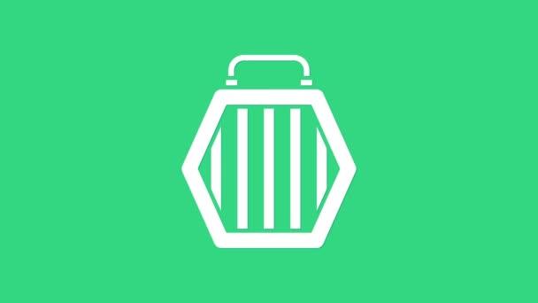 Bílá ikona tašky pro mazlíčky izolovaná na zeleném pozadí. Nosič pro zvířata, psy a kočky. Kontejner pro zvířata. Krabice na přepravu zvířat. Grafická animace pohybu videa 4K