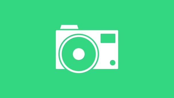 Ikona bílé foto kamery izolované na zeleném pozadí. Ikona fotoaparátu. Grafická animace pohybu videa 4K