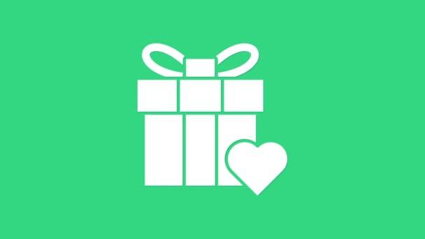 Bílá dárková krabice a srdce ikona izolované na zeleném pozadí. Valentýn. Grafická animace pohybu videa 4K