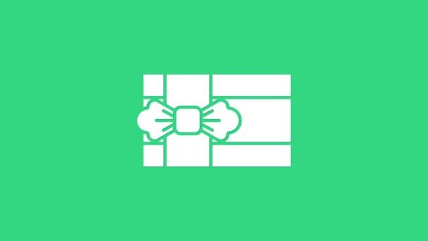 Fehér Ajándék doboz ikon elszigetelt zöld háttérrel. 4K Videó mozgás grafikus animáció