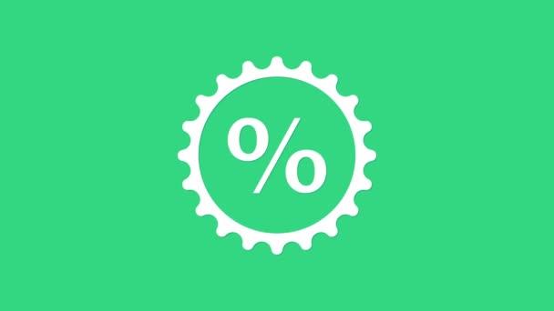 Fehér Kedvezményes százalékos címke ikon elszigetelt zöld háttérrel. Bevásárlócédula. Különleges ajánlat jel. Kedvezményes kuponok szimbólum. 4K Videó mozgás grafikus animáció