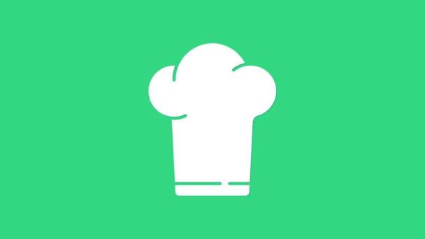 Ikona čepice White Chef izolované na zeleném pozadí. Symbol vaření. Kuchařská čepice. Grafická animace pohybu videa 4K