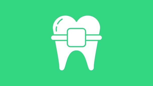 Weiße Zähne mit Zahnspange Symbol isoliert auf grünem Hintergrund. Ausrichtung der Zähne, Zahnreihe mit Zahnspange. Zahnkonzept. 4K Video Motion Grafik Animation
