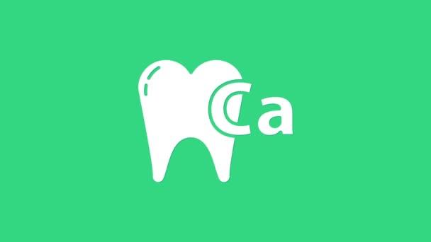 White Calcium for Zahn Symbol isoliert auf grünem Hintergrund. Zahnsymbol für Zahnklinik oder Zahnarztpraxis. 4K Video Motion Grafik Animation