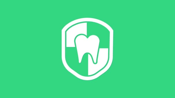 White Dental protection icon isolated on green background. Tooth on shield logo. 4K Video motion graphic animation