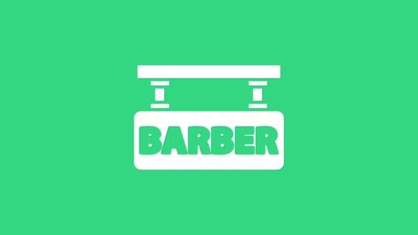 Fehér Barbershop ikon elszigetelt zöld háttérrel. Fodrászlogó vagy cégtábla. 4K Videó mozgás grafikus animáció