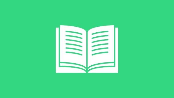 Fehér Nyílt könyv ikon elszigetelt zöld háttérrel. 4K Videó mozgás grafikus animáció