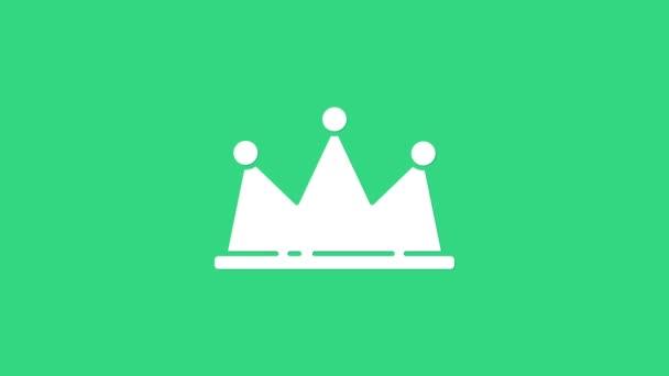 Fehér Korona ikon elszigetelt zöld alapon. 4K Videó mozgás grafikus animáció