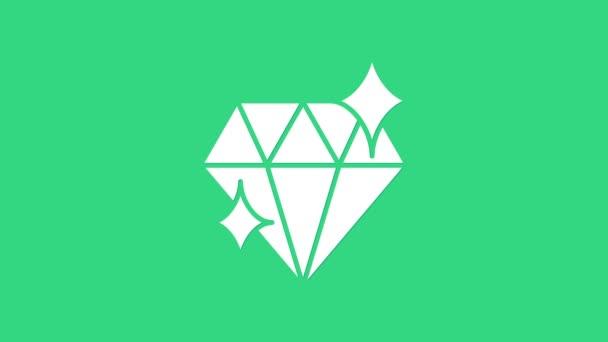Fehér Gyémánt ikon elszigetelt zöld háttérrel. Ékszer szimbólum. Ékkő. Március 8. Boldog Nők Nemzetközi Napja. 4K Videó mozgás grafikus animáció