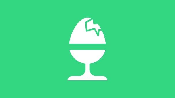 Weißes Hühnerei auf einem Standsymbol auf grünem Hintergrund. Frohe Ostern. 4K Video Motion Grafik Animation