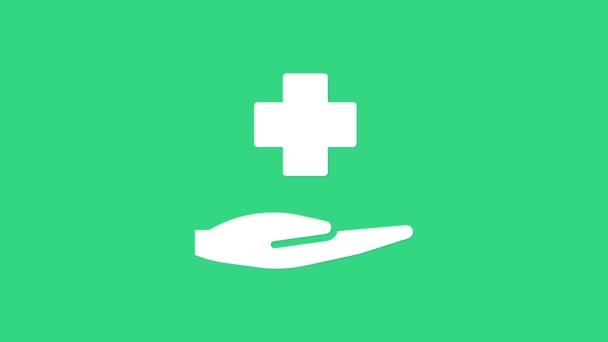 Lékařská ikona nemocnice White Cross izolovaná na zeleném pozadí. První pomoc. Diagnostický symbol. Značka medicíny a farmacie. Grafická animace pohybu videa 4K