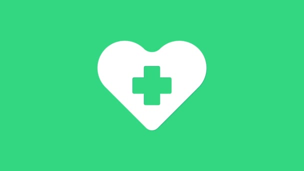White Heart with a cross icon isolated on green background. First aid. Healthcare, medical and pharmacy sign. 4K Video motion graphic animation
