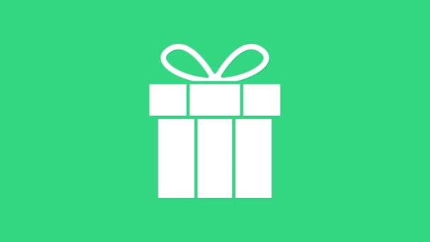 Fehér Ajándék doboz ikon elszigetelt zöld háttérrel. Boldog szülinapot! 4K Videó mozgás grafikus animáció