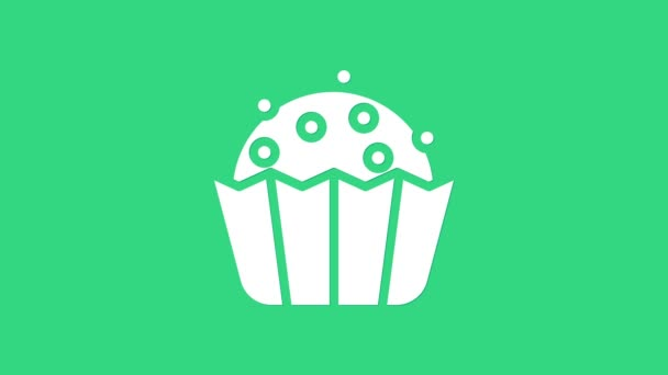 White Cupcake icon isolated on green background. 4K Video motion graphic animation