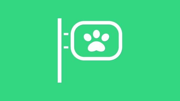 Fehér Kisállat ápolás ikon elszigetelt zöld háttérrel. Kisállat fodrászat. Fodrászat kutyáknak és macskáknak. 4K Videó mozgás grafikus animáció
