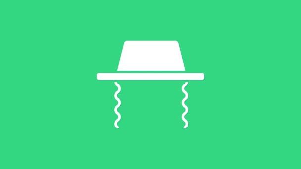 Fehér ortodox zsidó kalap oldalsó ikon elszigetelt zöld háttérrel. Zsidó férfiak hagyományos ruhában. Judaizmus szimbólumok. 4K Videó mozgás grafikus animáció