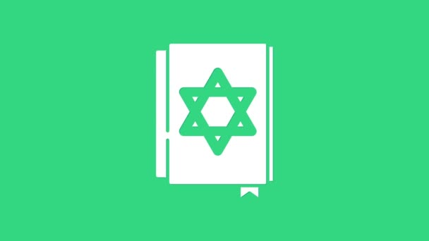 White Jewish torah book icon isolated on green background. Pentateuch of Moses. On the cover of the Bible is the image of the Star of David. 4K Video motion graphic animation