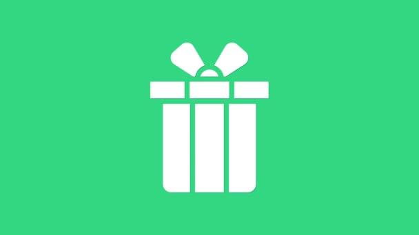 Fehér Ajándék doboz ikon elszigetelt zöld háttérrel. Boldog karácsonyt és boldog új évet! 4K Videó mozgás grafikus animáció