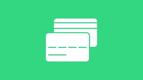 Fehér hitelkártya ikon elszigetelt zöld alapon. Online fizetés. Készpénzfelvétel. Pénzügyi műveletek. Bevásárlótábla. 4K Videó mozgás grafikus animáció