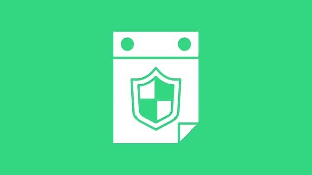 Weißer Kalender mit Schildsymbol auf grünem Hintergrund. Versicherungskonzept. Wachschild. Sicherheit, Sicherheit, Schutz, Privatsphäre. 4K Video Motion Grafik Animation
