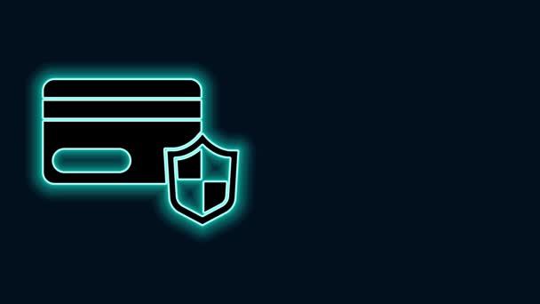 Ragyogó neon vonal Hitelkártya pajzs ikon elszigetelt fekete alapon. Online fizetés. Készpénzfelvétel. Pénzügyi műveletek. Bevásárlótábla. 4K Videó mozgás grafikus animáció