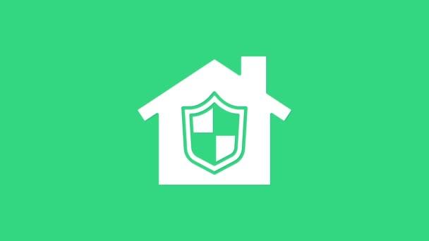 Fehér Ház védelem alatt ikon elszigetelt zöld alapon. Otthon és pajzs. Védelem, biztonság, védelem, védelem, védelem. 4K Videó mozgás grafikus animáció