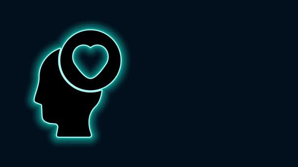 Világító neon vonal Emberi fej szív ikon elszigetelt fekete háttérrel. Szerelmi koncepció emberi fejjel. 4K Videó mozgás grafikus animáció