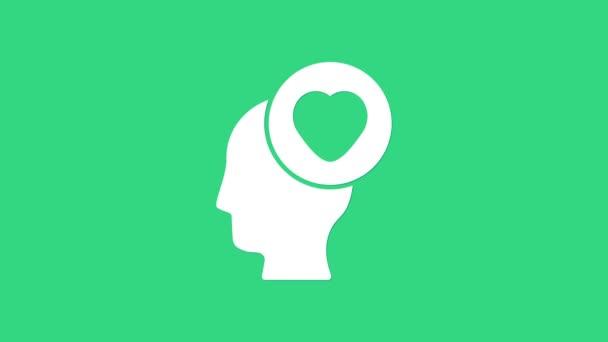 Bílá lidská hlava s ikonou srdce izolované na zeleném pozadí. Milostný koncept s lidskou hlavou. Grafická animace pohybu videa 4K
