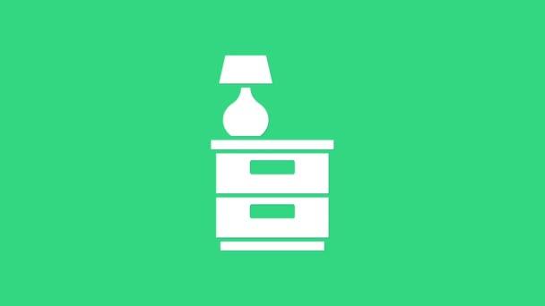 Bílý nábytek noční stolek s ikonou lampy izolované na zeleném pozadí. Grafická animace pohybu videa 4K