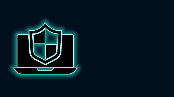 Zářící neonová čára Laptop chráněna štítem ikona izolované na černém pozadí. PC zabezpečení, firewall technologie, ochrana soukromí. Grafická animace pohybu videa 4K