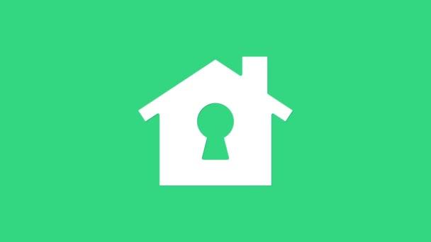 Weißes Haus unter Schutz Ikone isoliert auf grünem Hintergrund. Heimat und Schild. Schutz, Sicherheit, Sicherheit, Schutz, Verteidigungskonzept. 4K Video Motion Grafik Animation