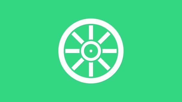 Fehér Régi fa kerék ikon elszigetelt zöld háttérrel. 4K Videó mozgás grafikus animáció