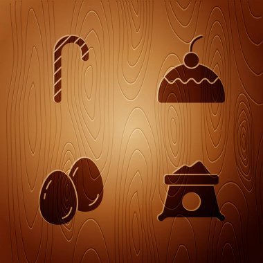 Set Bag of flour, Christmas candy cane, Easter eggs and Cake on wooden background. Vector. icon