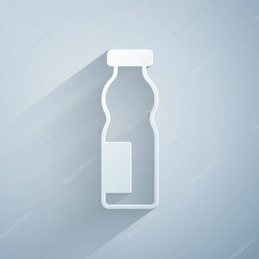 Paper cut Drinking yogurt in bottle icon isolated on grey background icon