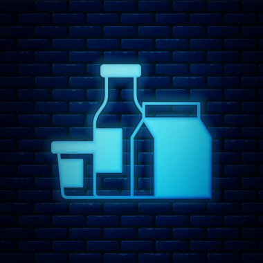 Glowing neon Milk product icon isolated on brick wall background.  Vector. icon