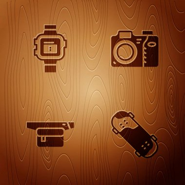 Set Skateboard trick, Wrist watch, Waist bag of banana and Photo camera on wooden background. Vector icon