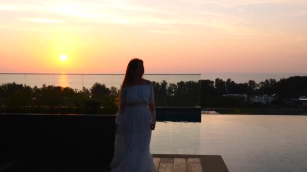 Slow Motion of Happy Woman Silhouette Dancing on Sunset at Hotel Rooftop