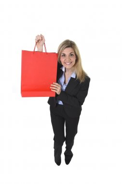 young happy beautiful woman in business suit in excited face expression holding red shopping bag
