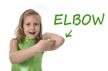 cute little girl pointing her elbow in body parts learning English words at school