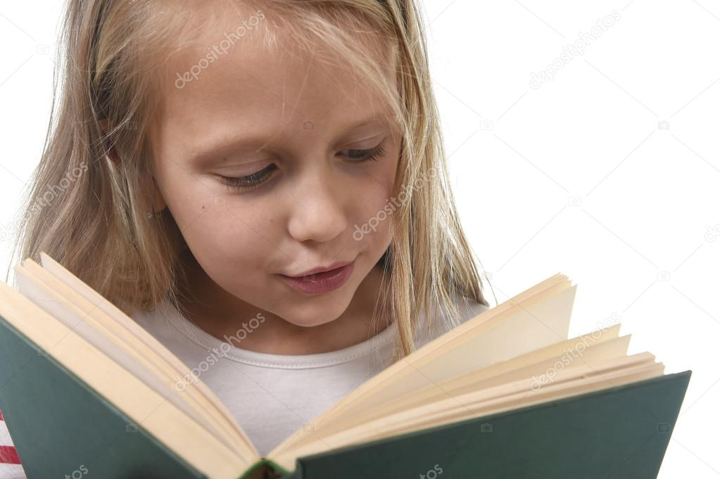 Young Sweet Little 6 Or 7 Years Old With Blond Hair Girl Reading A