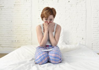 young sad woman crying frustrated after checking negative or positive pregnancy test