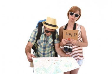 young tourist couple reading city map looking lost and confused loosing orientation with girl carrying travel backpack