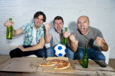 friends fanatic football fans watching game on tv celebrating goal screaming crazy happy